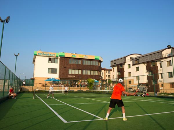 playing on tennis artificial grass